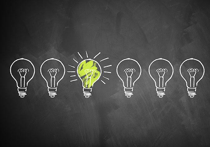 Tecknad bild av sex glödlampor där en lyser.