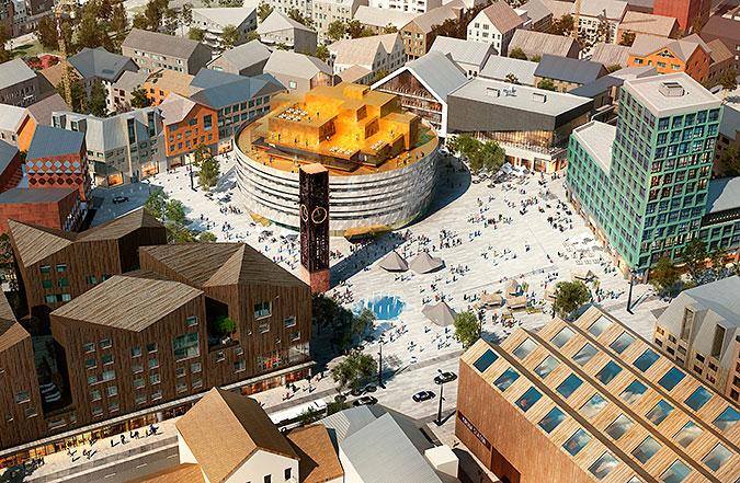 En arkitektskiss över framtidens Kiruna där bebyggelsen ses lite från ovan. I mitten står det nya stadshuset i mitten av ett torg som flankeras ac byggnader i iloika färger och former. På torget står även klocktornet från det gamla stadshuset.